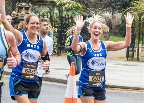 Two Mind runners celebrate and wave to the crowds