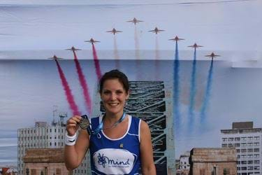 Girl with medal after finishing Great North Run