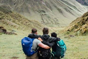 Group hugging on summit of amazing view
