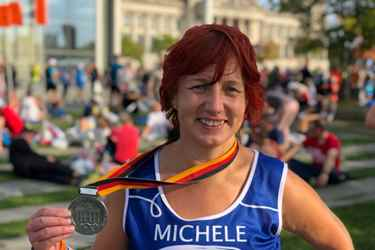 Happy lady with Berlin Marathon medal