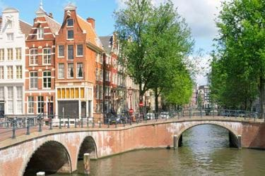 A picture of the city of Amsterdam on a sunny day