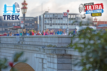 Thames Path Challenge Ultra Series walkers going over London Bridge