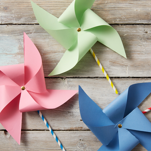Colourful paper pinwheels with fun stripy straws as bases
