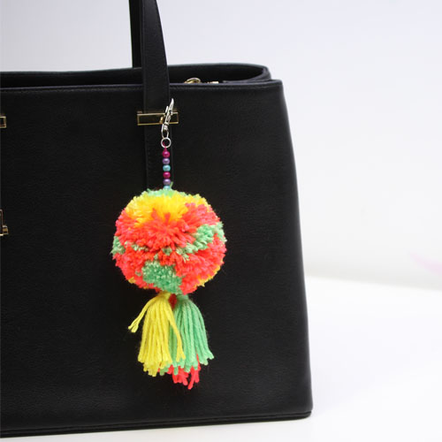 Multi-coloured pom-pom for a bag or key ring
