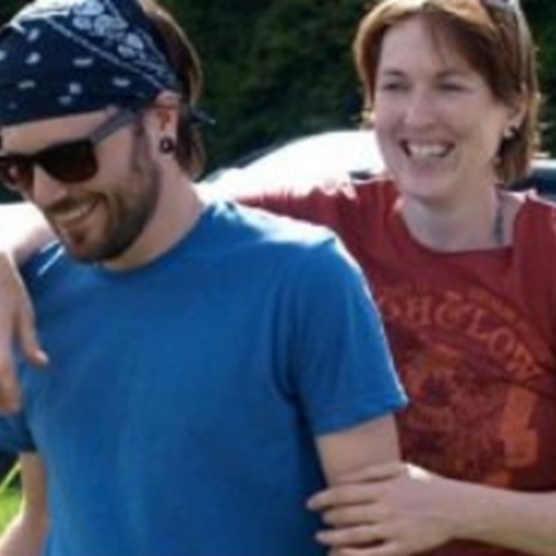 Photo of Kate and her partner relaxed and smiling