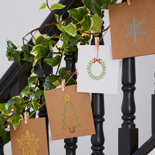 Handmade cards hanging on bannister
