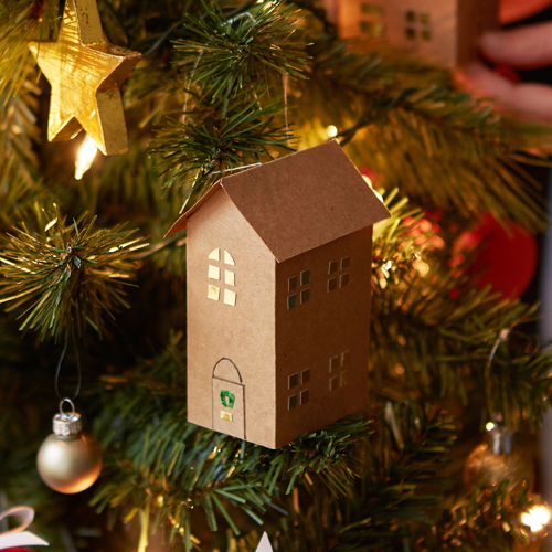 Paper house decoration hung on Christmas tree
