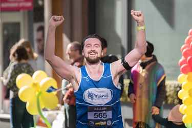 Mind male runner with hands in the air