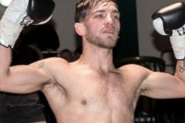 male lifting hands hands in the air, wearing boxing gloves