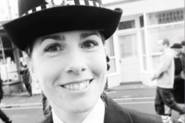 female police officer smiling, black and white photo