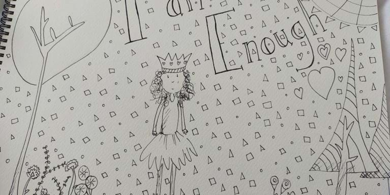 Drawing with the words 'I am enough' on it.