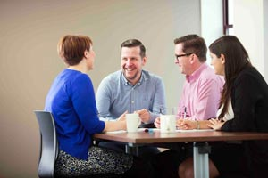 Group of engaged people talking in a meeting room