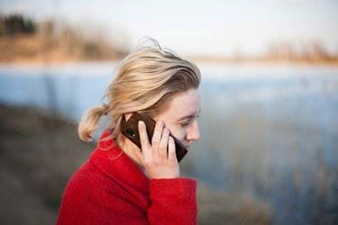 Person in a red coat speaking on the phone